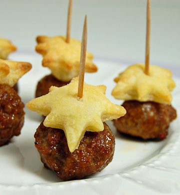 Italian sausage bites topped with a puff pastry star for the perfect easy appetizer. A festive and classy dish to celebrate any occasion!