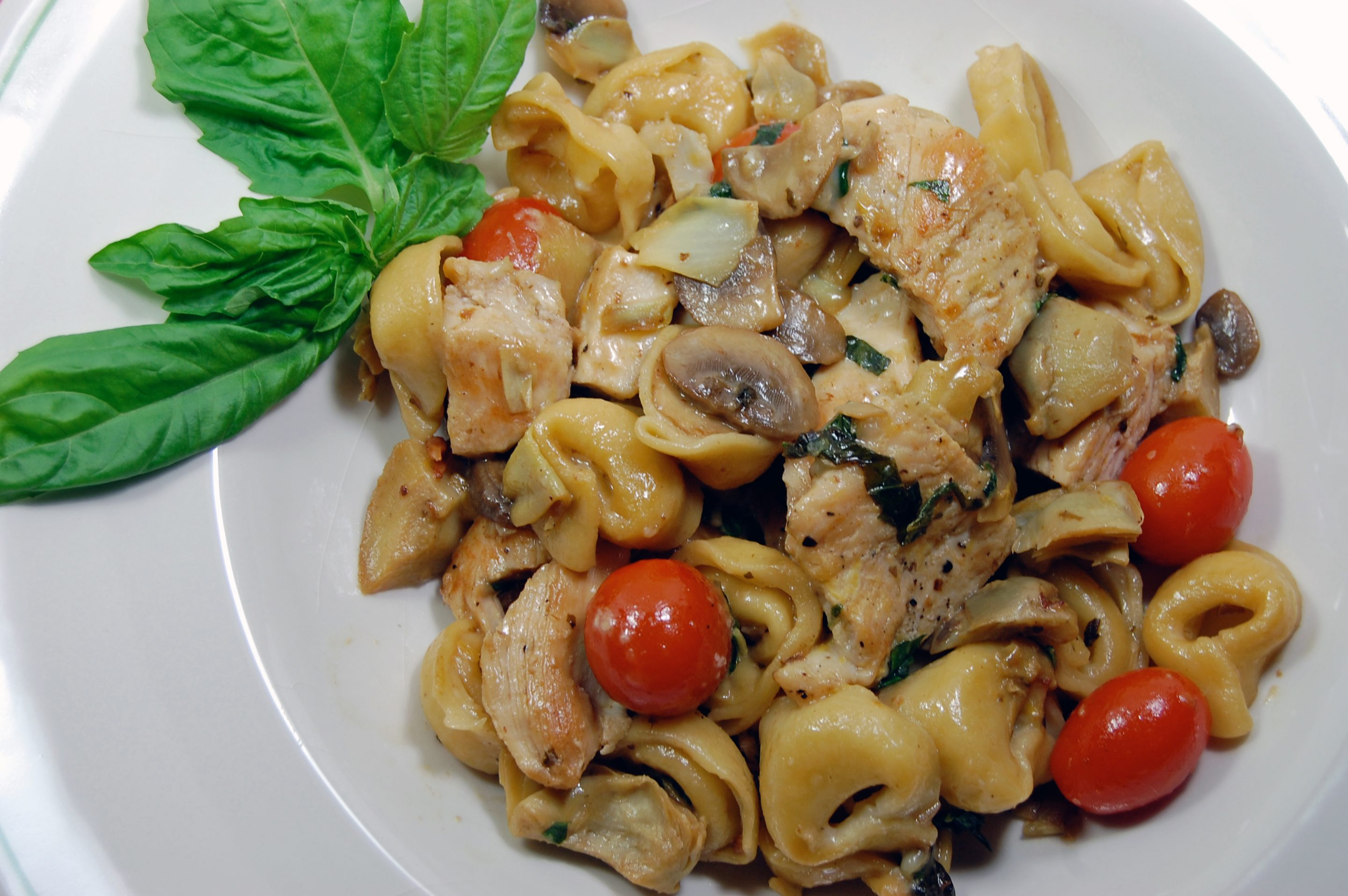 Chicken Mushrooms And Artichoke Hearts With Cheese Tortellini In A