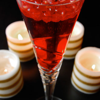 Pomegranate Champagne is a quick festive drink to ring in the new year. Pomegranates rise to the top with the push of your bubbly champagne, making for a beautiful classy drink!