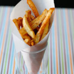 Oven-baked fries with a bit of Cajun seasoning creates our favorite Cajun Fries.