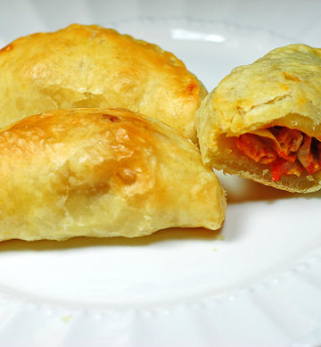 Cheese and Olive Empanadillas are put together with puff pastry for an empanada appetizer.
