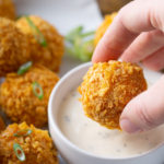 buffalo chicken ball dipped into ranch sauce
