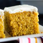 pumpkin bar with cream cheese frosting on a white plate