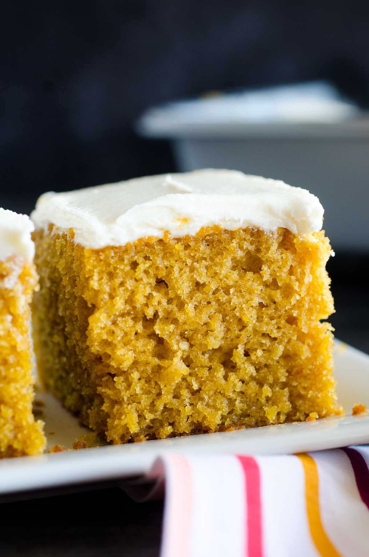 pumpkin bar with cream cheese frosting on a plate