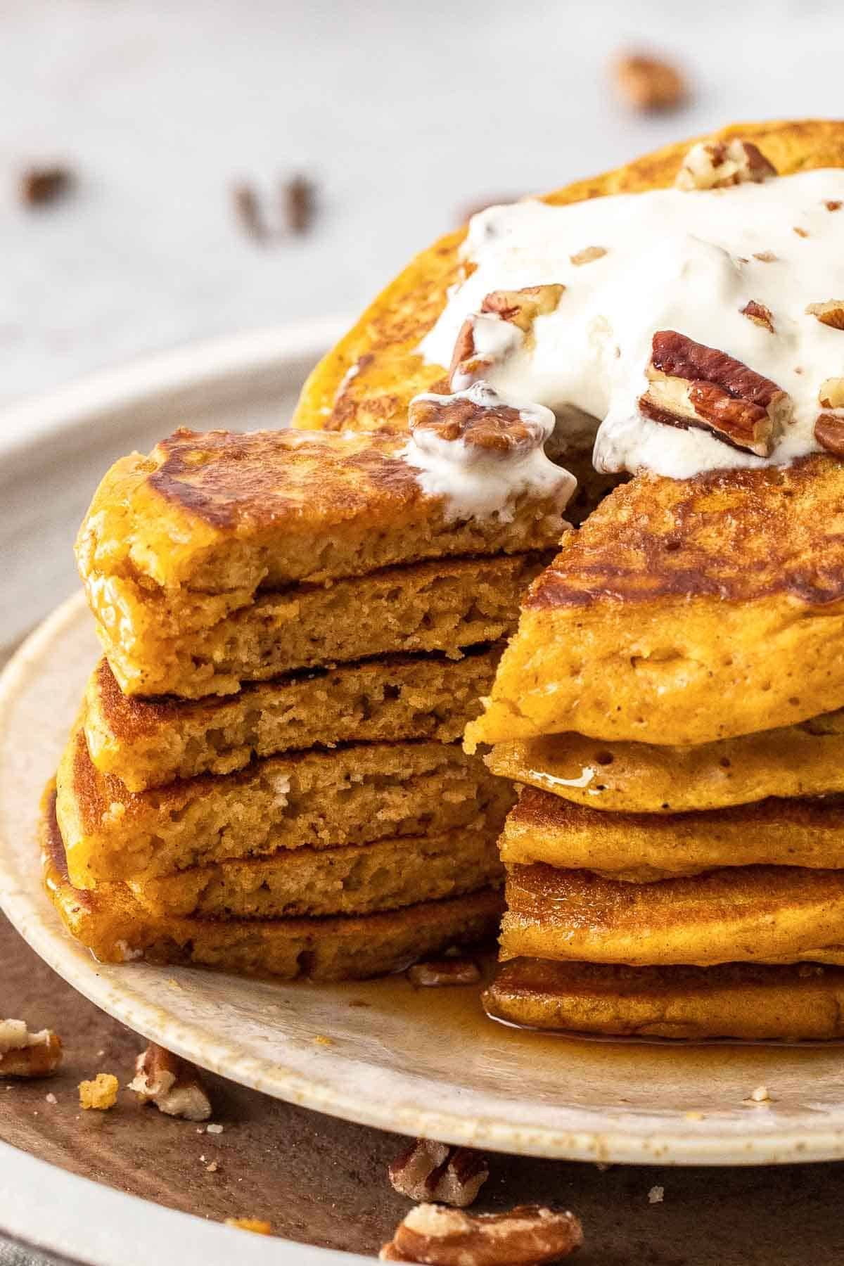 slice out of a stack of pumpkin spice pancakes