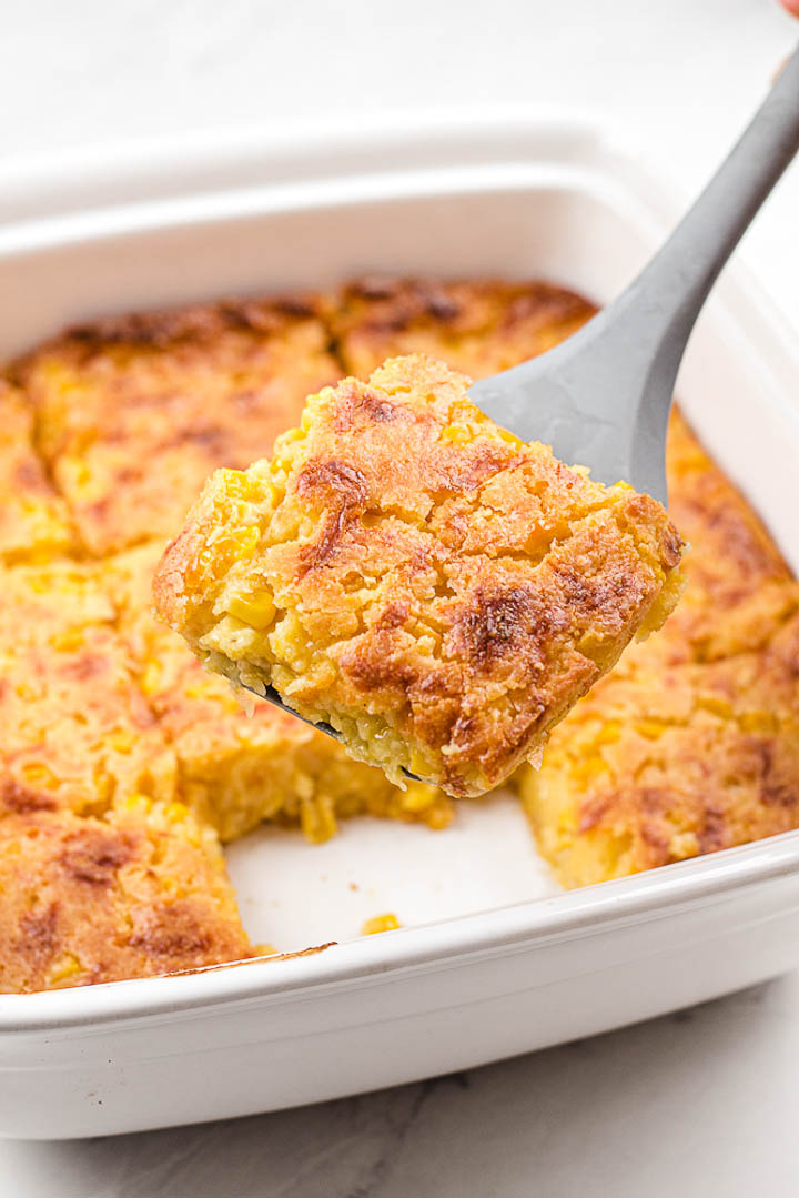 corn casserole scooped from pan