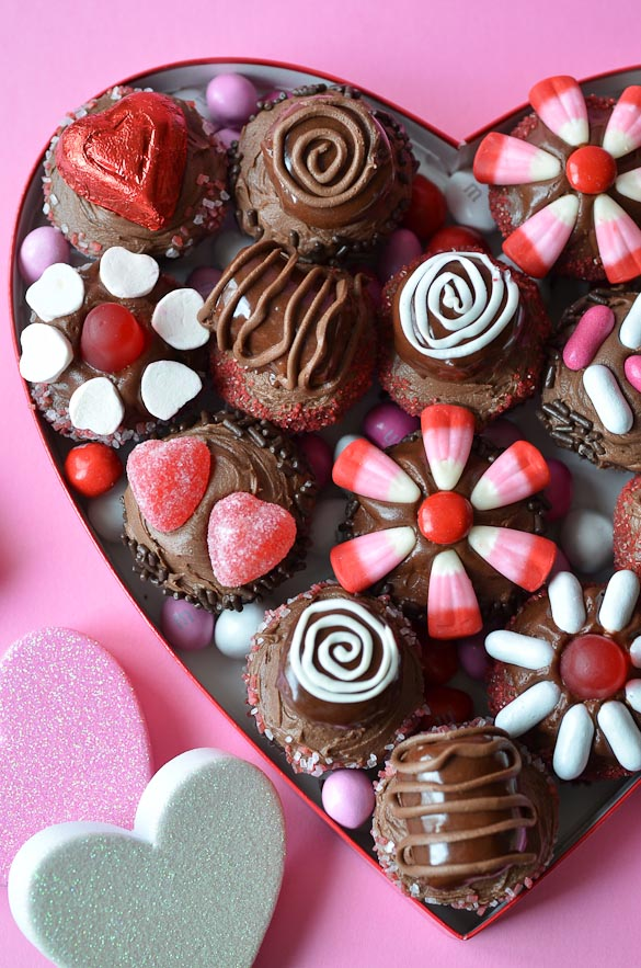 heart shaped box filled with miniature cupcakes and candies