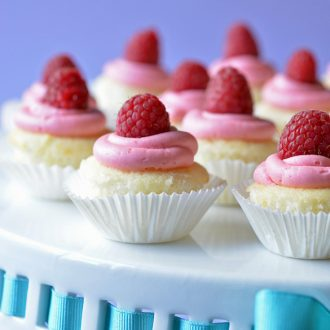 Raspberry Lemon Cupcakes - lemon cupcake base with a delectable raspberry frosting.