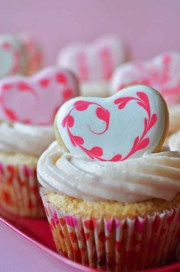 cupcakes topped with heart shaped sugar cookies