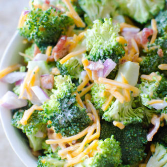 A fresh crisp broccoli salad tossed with a simple tangy homemade dressing. Broccoli salad is a quick salad everyone loves for any gathering, potluck, party, etc.