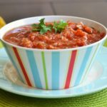 fresh salsa in a colorful striped bowl