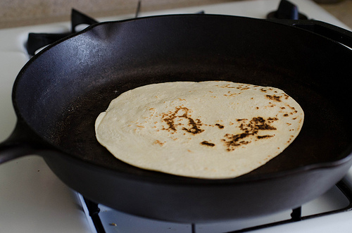 Tortillas Cooking in cast iron skillet