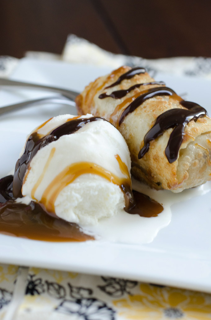 ice cream with fried egg roll and chocolate caramel sauces