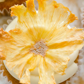 cupcake topped with dried pineapple flower