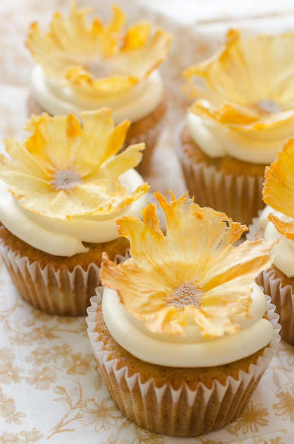 cupcakes topped with dried pineapple flowers
