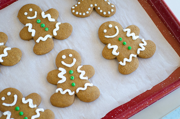 decorated gingerbread man cookies on a baking sheet