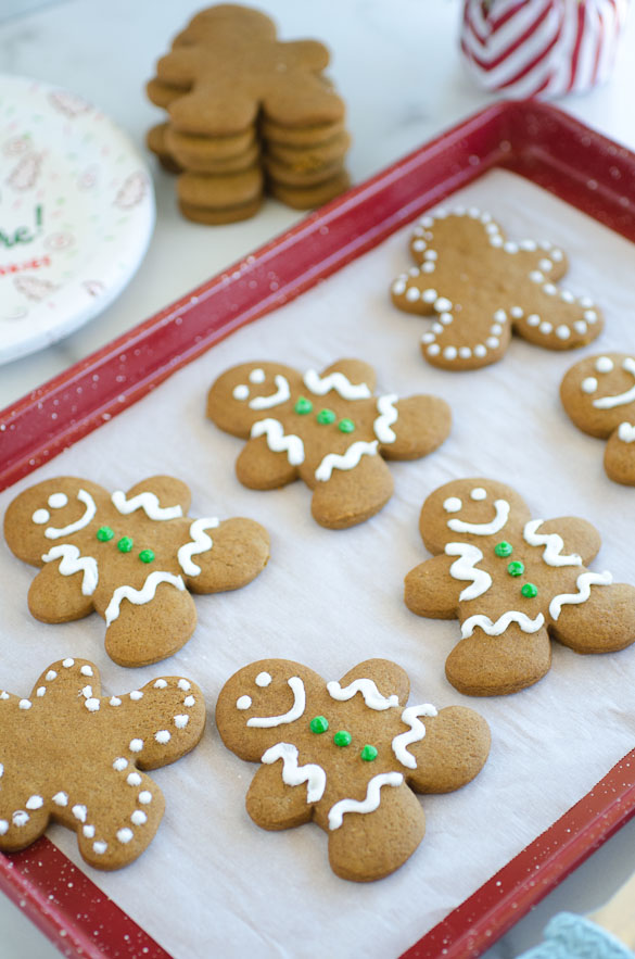 decorate gingerbread man cookies on a baking sheet