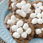 Hot Chocolate Cookies are chocolate cookies made with hot cocoa and topped with gooey mini marshmallows that puff perfectly in the oven. Warm up this winter with our favorite Hot Chocolate Cookies!