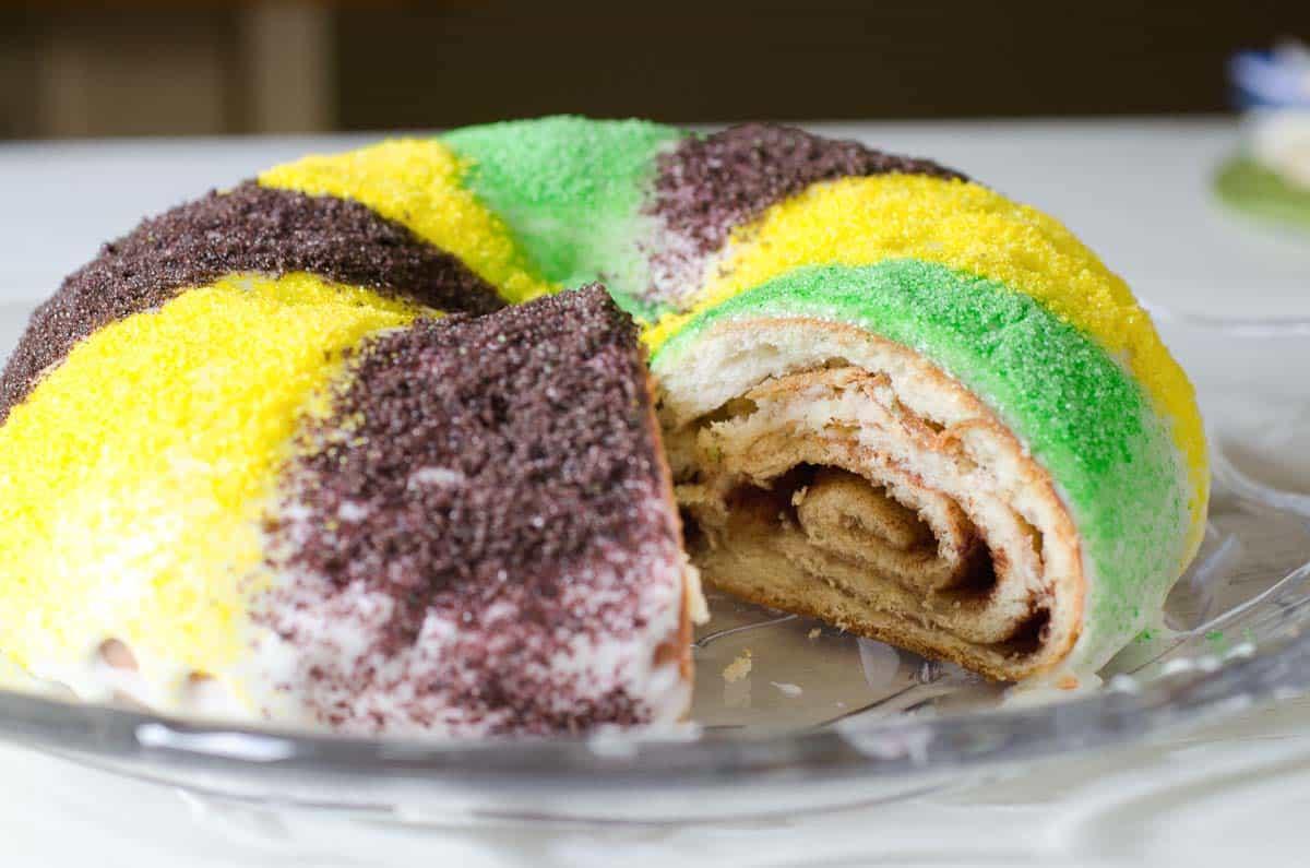 purple yellow green round king cake with cinnamon swirl