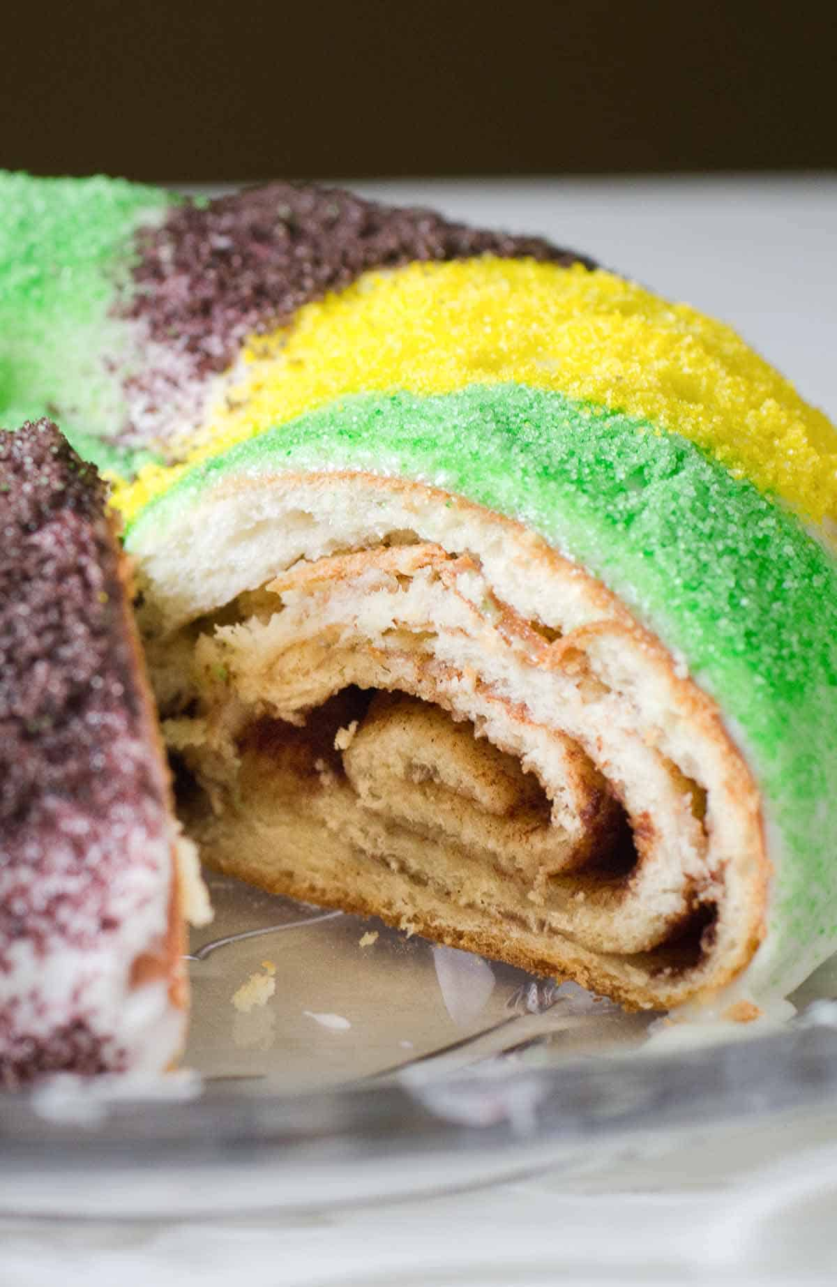 king cake with cinnamon swirl and green gold purple sugar