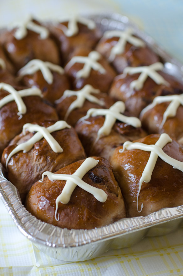 The rolls are brushed with a simple sugary syrup and topped with a white chocolate cross.  You won't believe how soft and wonderful they are!