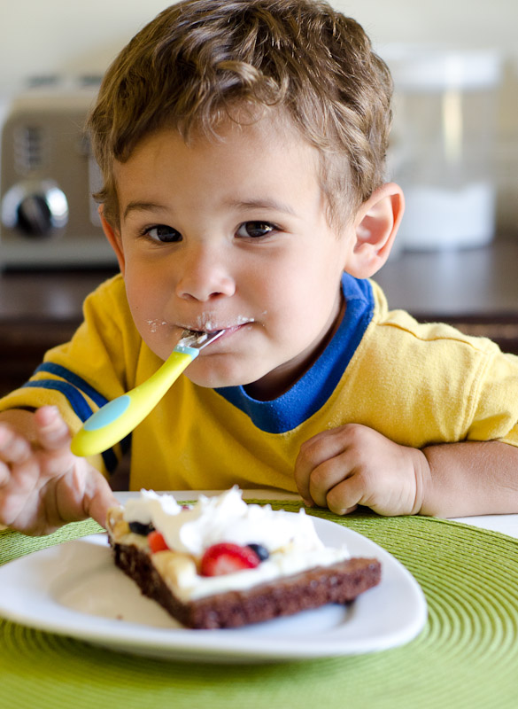 Child eating dessert brownie.