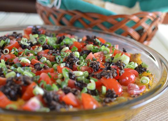 Baked Southwestern Chile Dip is a super easy dip that can be prepped up to 4 hours in advance. Throw in the oven for only 20 minutes before topping with fresh tomatoes and green onions.