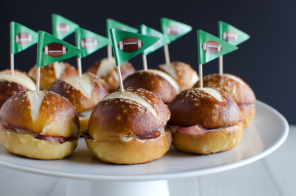 These Ham and Cheese Soft Pretzel Sliders are the perfect finger food for your tailgate party on game day. Everyone loves a good soft pretzel bun!
