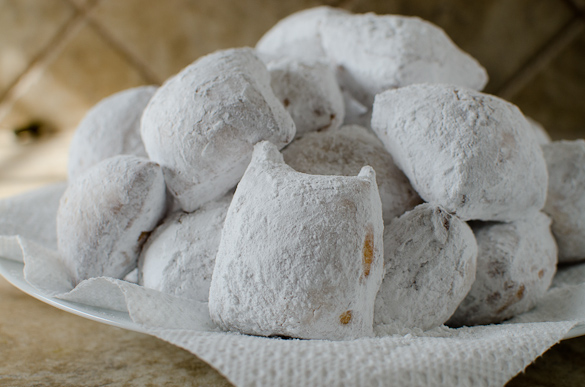 Beignets are snowy pillows of sugar and dough that are claimed as Louisiana's state doughnut.  Don't wait to try beignets in New Orleans, you can easily make these delights at home with this tried and true beignet recipe!
