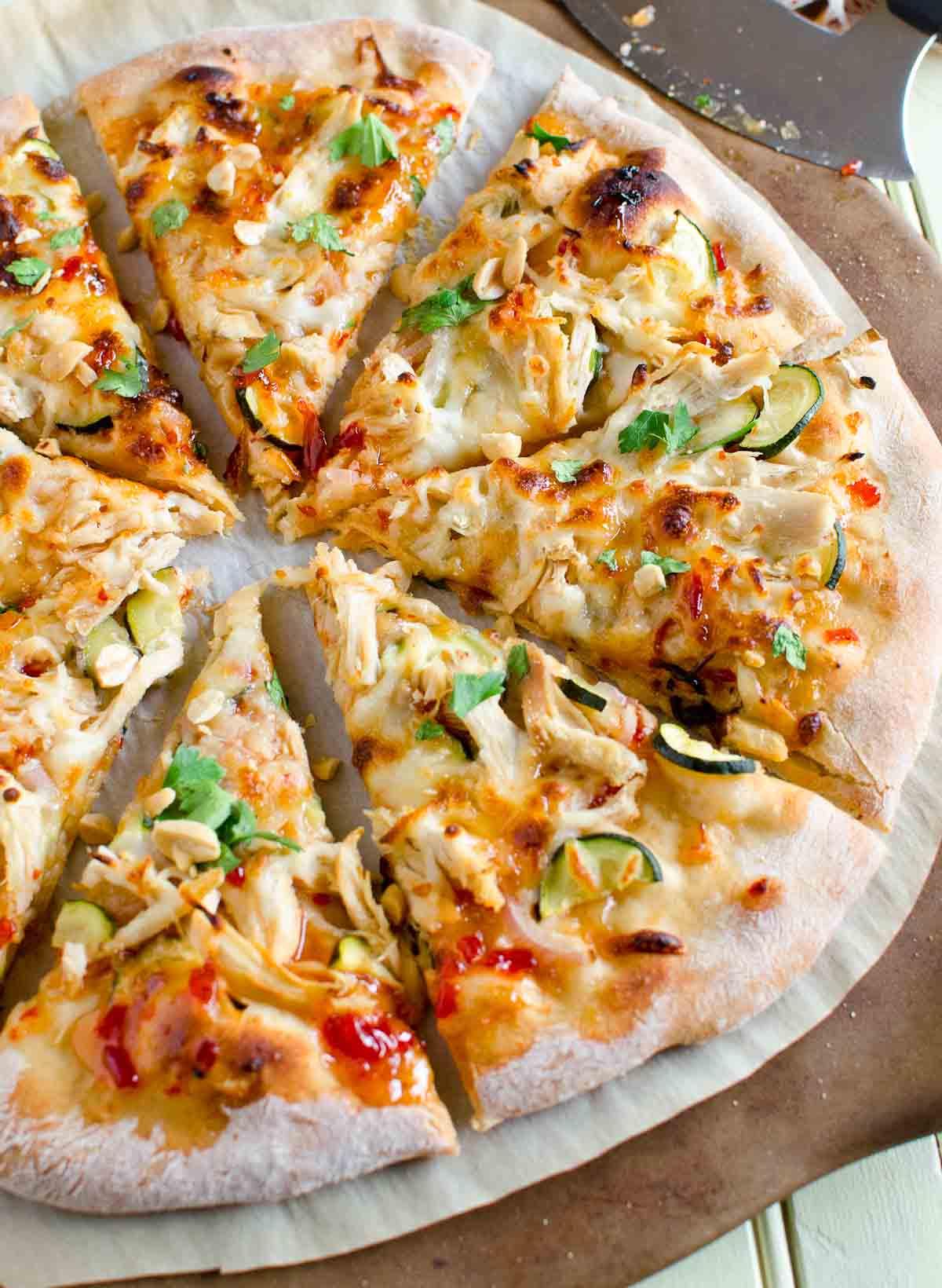 entire thai chicken pizza cut into eight slices