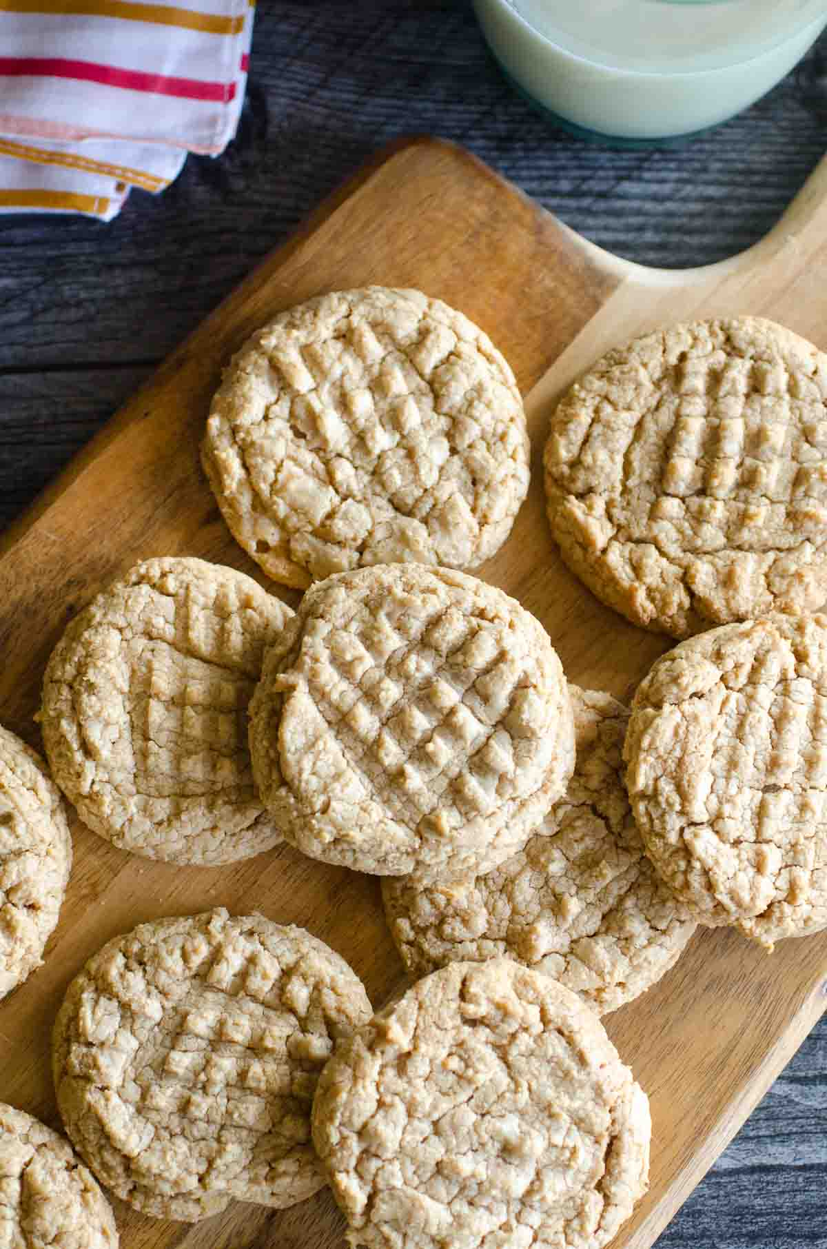 peanut butter cookies spread on a wooden serving platter