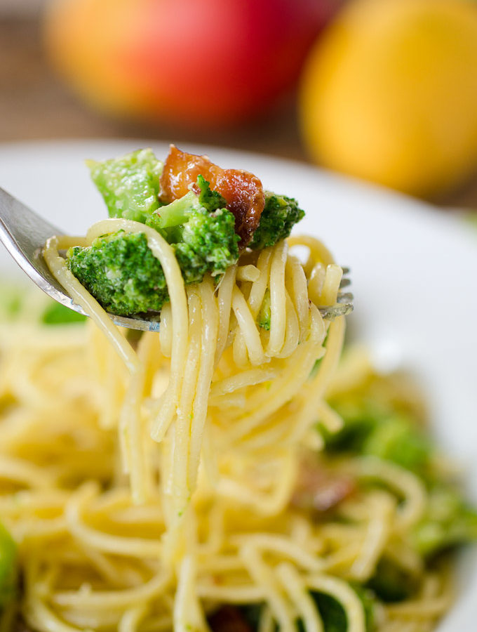 forkful of spaghetti noodles with broccoli and bacon