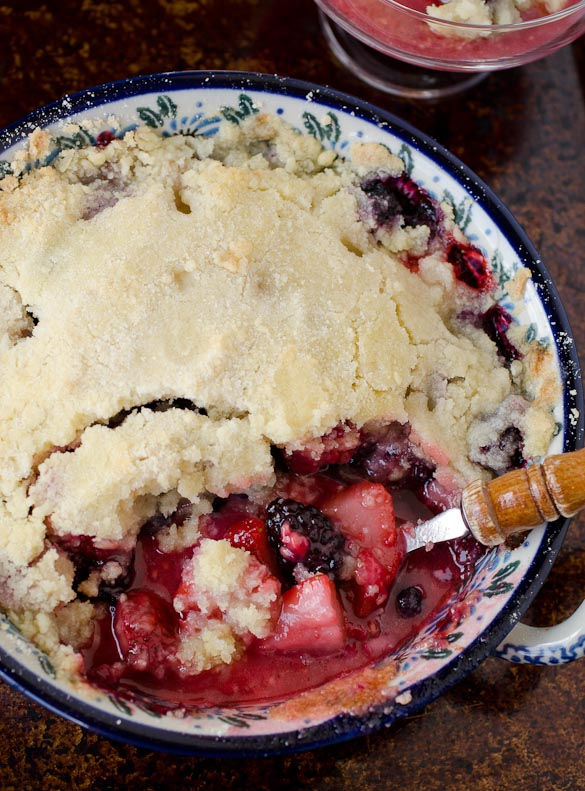 Our favorite tried and true Berry Cobbler Recipe with a crumb topping. This Favorite Berry Cobbler stands amazing on its own or is served warm with ice cream.