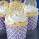 These zesty lemon cupcakes are topped with a fluffy vanilla cream frosting and crispy lemon peels.