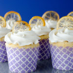 These zesty lemon cupcakes are topped with fluffy vanilla cream frosting and a crispy candied lemon peel.