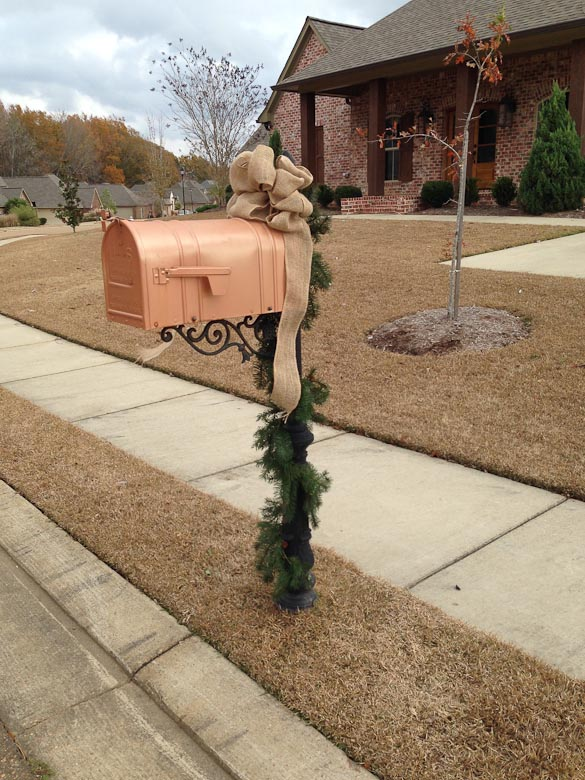Christmas garland and burlap bow on mailbox by SeededAtTheTable.com