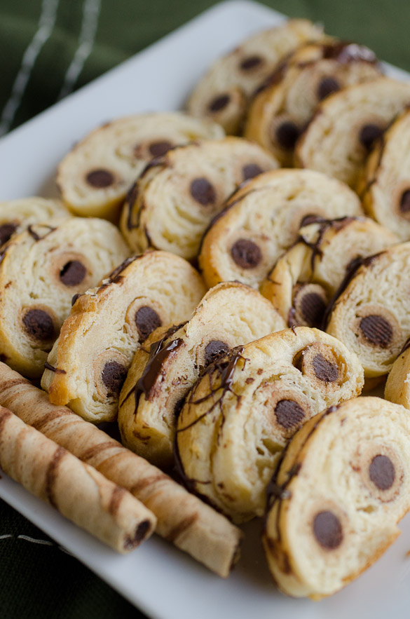Refrigerated crescent rolls baked with Pirouline cookies in the center, then sliced for a party app.  SeededAtTheTable.com