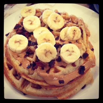 "The ""All Shook Up"" from Anna's House in Grand Rapids, MI - Waffles topped with bananas and peanut butter, sprinkled with bacon."