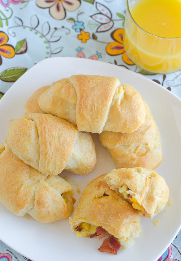 Bacon, scrambled eggs and cheddar cheese all rolled up in a crescent rolls for breakfast in one! by SeededAtTheTable.com
