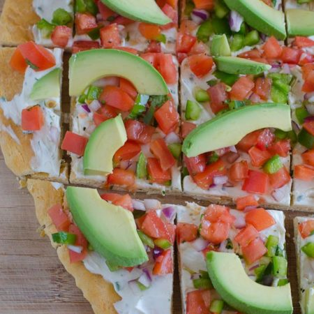 This Fresh Salsa and Cream Cheese Pizza is a perfect lunch or party appetizer. Freshly made salsa is sprinkled over top a layer of garlic-infused cream cheese with a crust made from refrigerated crescent dough.