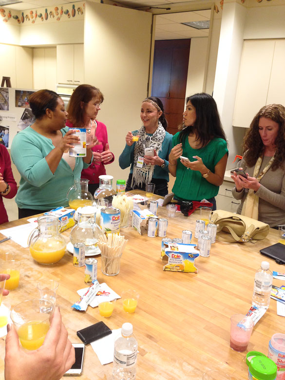 DOLE Test Kitchen - bloggers sampling products from @dolefood via @SeededTable #dolesummit