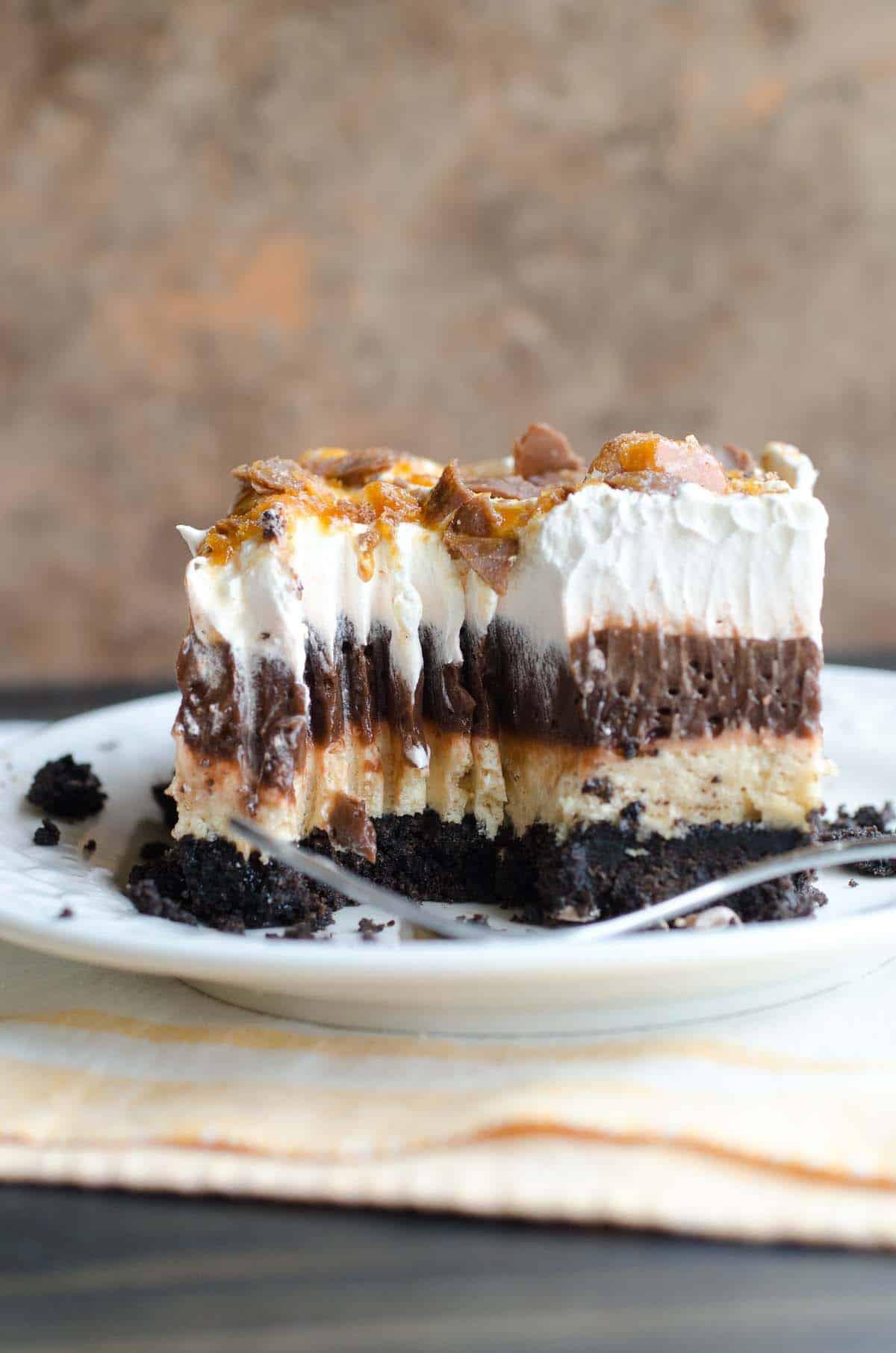 layered chocolate dessert with oreo crust
