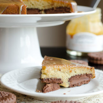 Slice of banana cake with chocolate cookies.