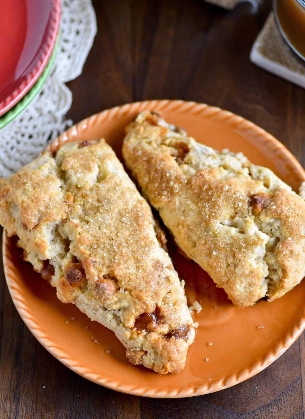 two apple pie scones on an orange plate