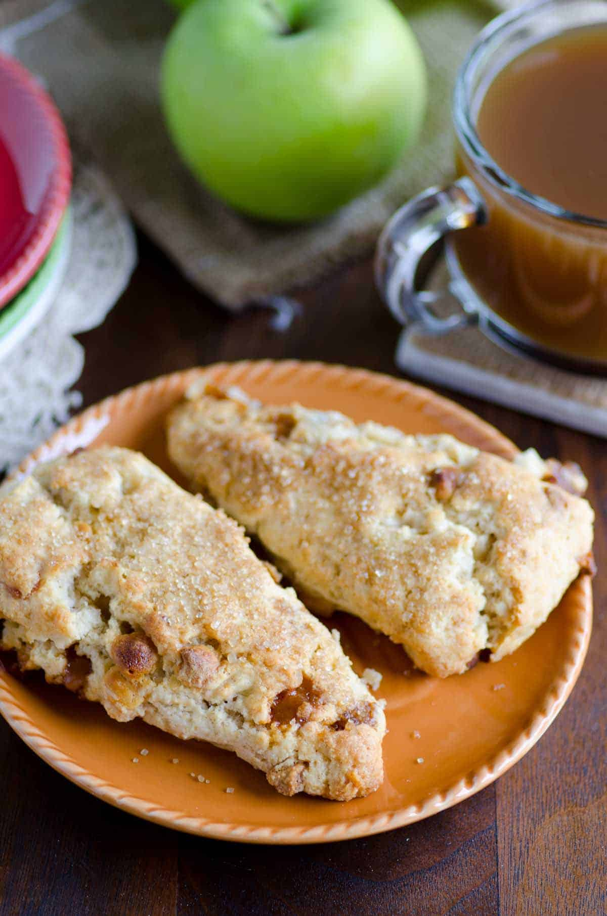 apple pie scones on a plate with coffee