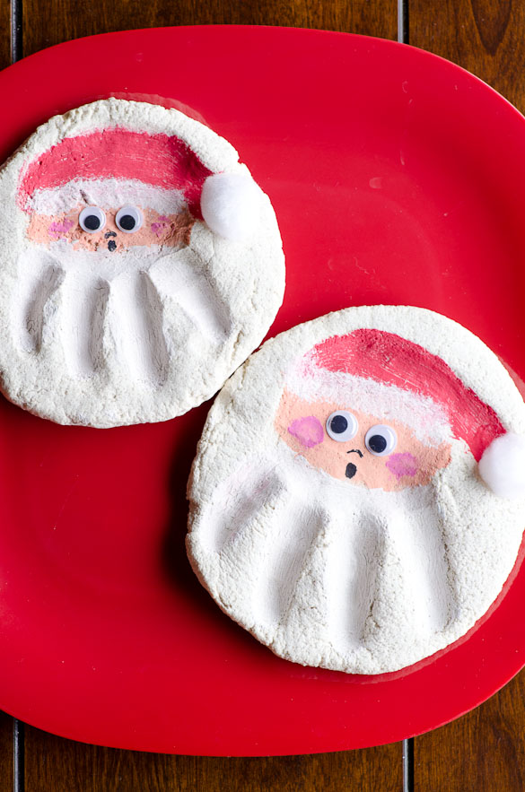 Salt Dough Santa Handprints - Just flour, salt and water! Bake or air dry then paint. Easy as 1-2-3 and a perfect homemade gift for the grandparents!