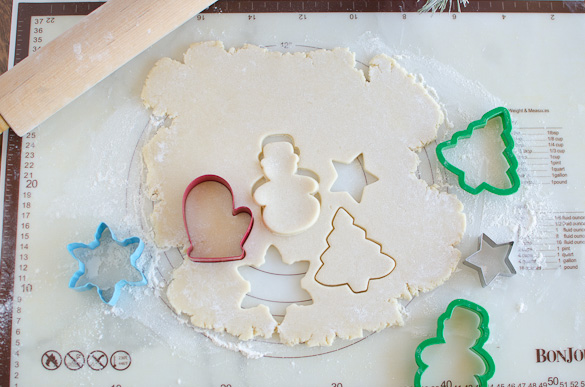 christmas cookie cutters in sugar cookie dough