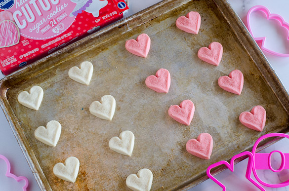 cookie sheet with heart shaped cookie dough