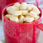 shortbread cookies with red and pink sprinkles in a heart mug