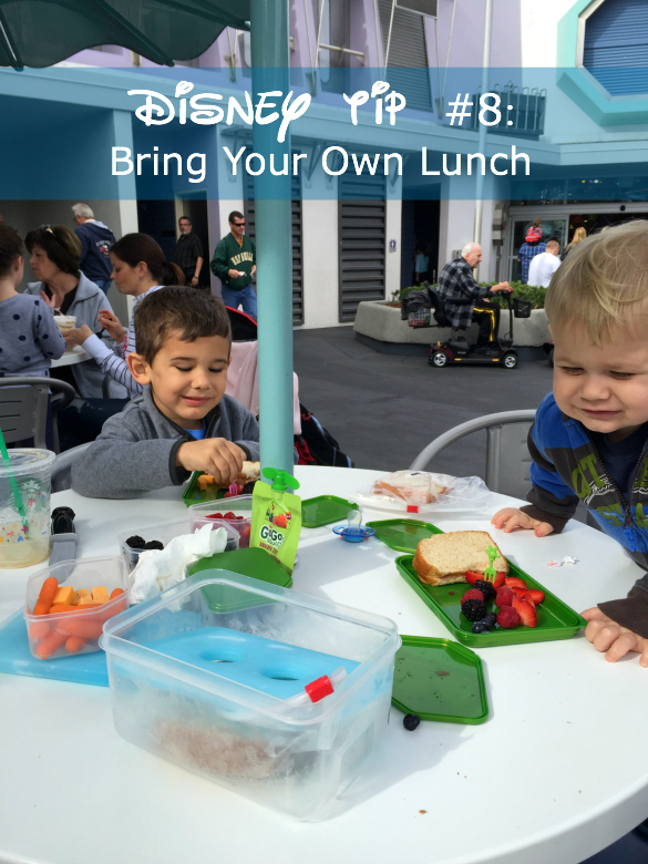 Disney tip to pack lunch with photo of boys eating.
